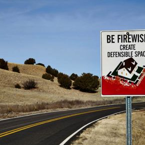 Road sign for wildfire defensible space